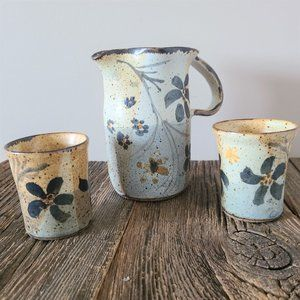 Hand made pottery. Ceramic pitcher and cups.